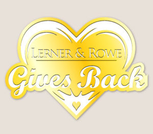 Lerner and Rowe Gives Back Yellow Heart