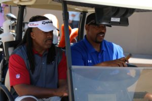 golfers in cart | charity golf classic 2016