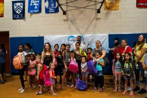 Kevin Rowe Group Photo with Families | 2019 Phoenix Backpack Giveaway