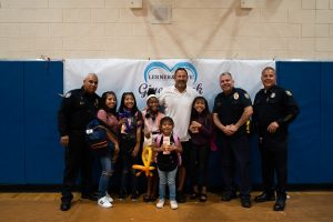 Phoenix Students, Police and Kevin Rowe | Backpack Giveaway