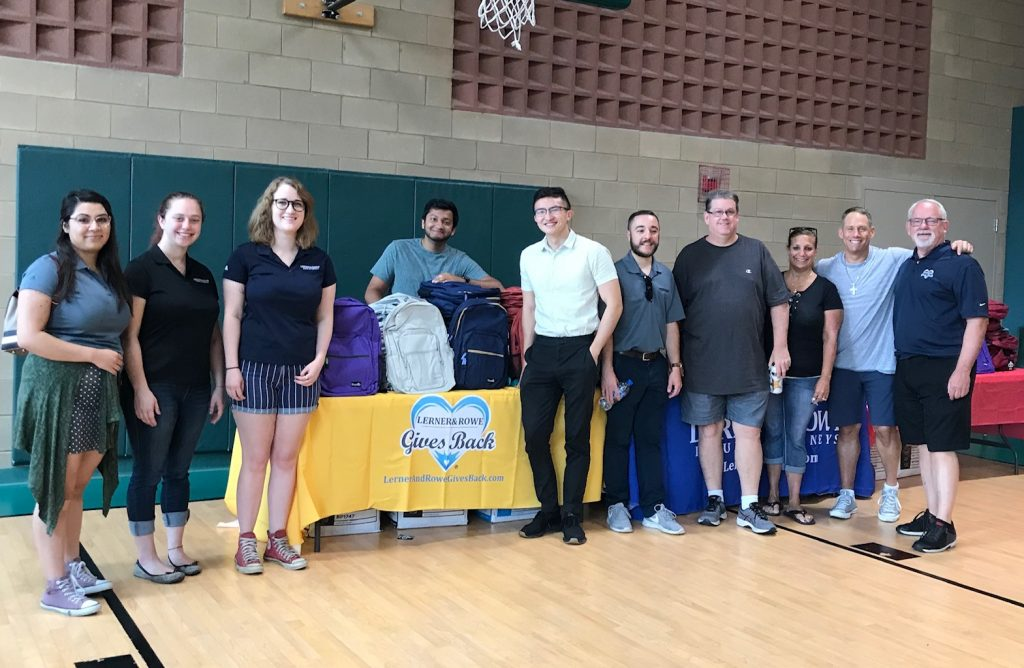 Lerner and Rowe Gives Back - Elgin Backpack Giveaway Group Photo