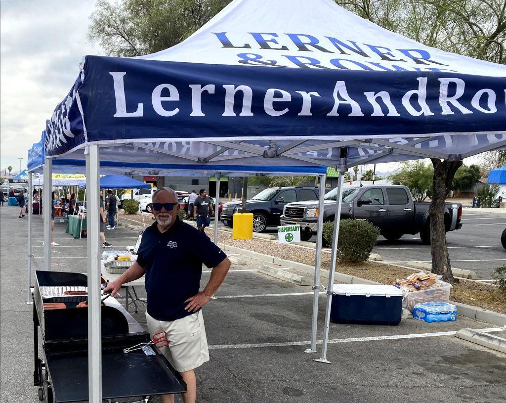 Lerner and Rowe serving hot dogs at a Las Vegas United Community event