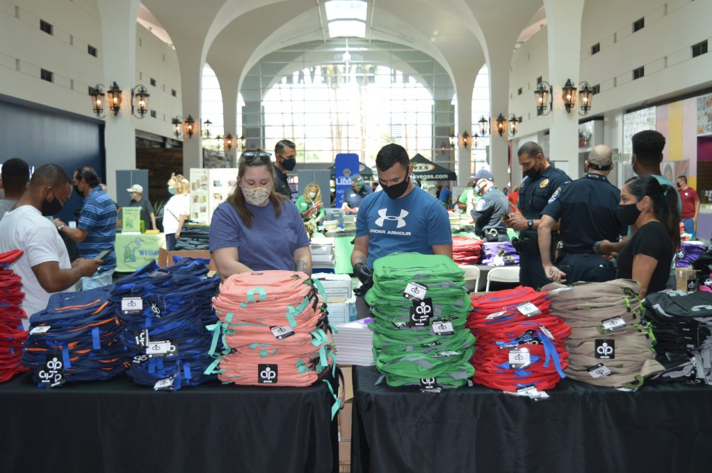 Table of backpacks donated by Lerner and Rowe Gives Back